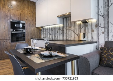 Modern interior design kitchen with small table and trees wallpaper