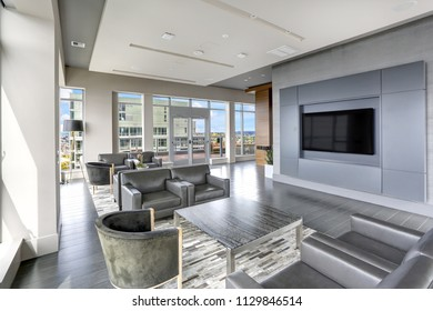 Modern interior design of living area with leather armchairs and exit to luxurious terrace. Northwest, USA