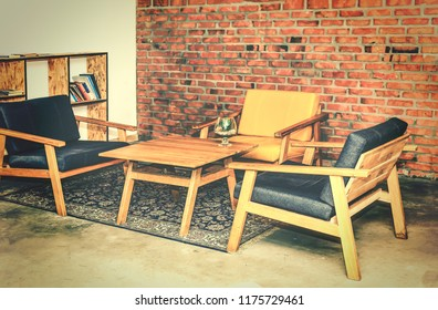 Modern interior design of meeting room, loft design. tables and chairs, brick wall, business negotiations
