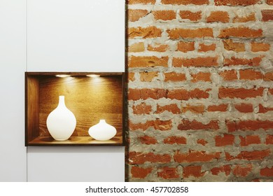 Modern interior detail: Old brick wall and contemporary design lamp interior