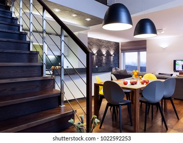 Modern interior - dining table and staircase