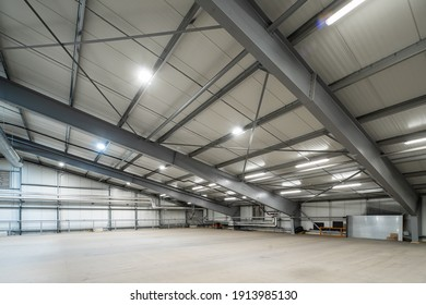 Modern interior of huge empty warehouse. New distribution storehouse. Metal construction. Industrial architecture.