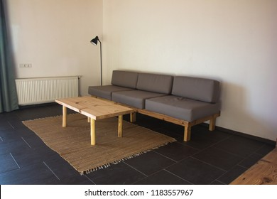 Modern interior of living room with grey sofa, coffee table