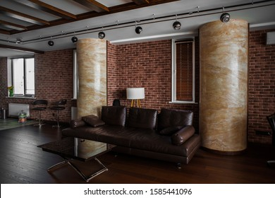 Modern interior. Loft style, perfect interior. The brightness of colors and the simplicity of the interior. photos and ideas for decorating an apartment. Columns in the room