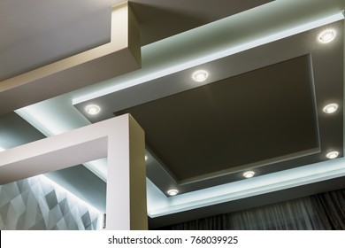 modern interior room with tiered ceilings and partitions. Modern technologies of construction and interior