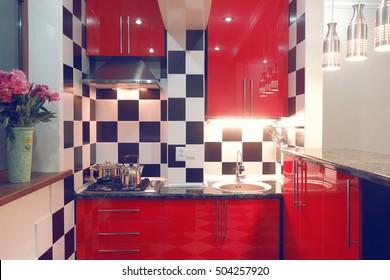 Modern interior of small red kitchen