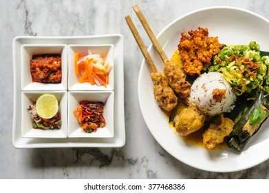 Modern interpretation of Indonesian Nasi Campur with sate, Ubud, Bali, Indonesia.