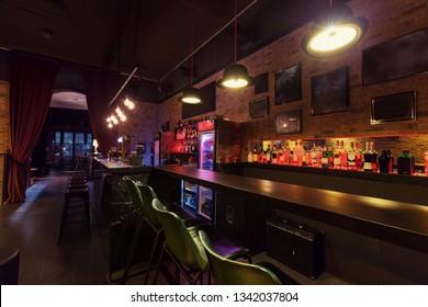 Modern jazz bar interior design, lamps above bar counter