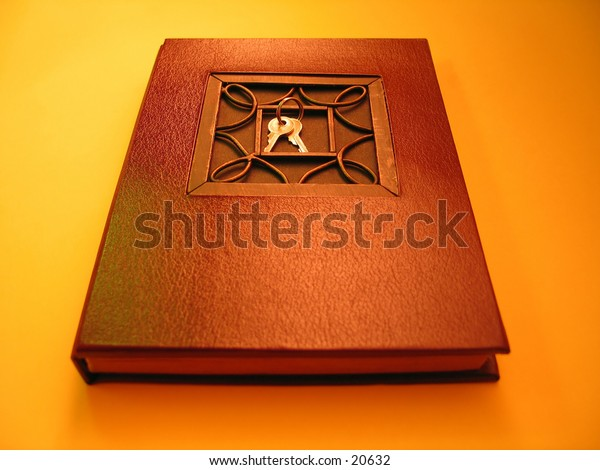 A modern journal with a set of keys sitting on the top.