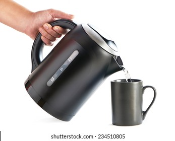 Modern kettle pouring water into a cup on a white background