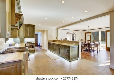 Modern khaki kitchen room in large luxury house with bright dining area
