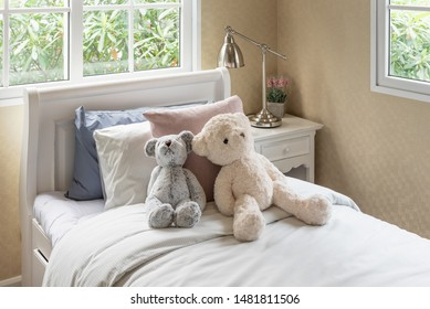 modern kid's bedroom with pilloes and doll onbed, interior design decoration concept