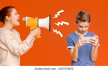 Modern kids problems. Gadget addicted boy playing mobile games on cellphone, ignoring his screaming with megaphone mother, orange background
