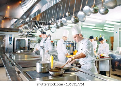 Modern kitchen. The chefs prepare meals in the restaurant's kitchen.