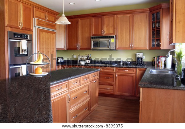 Modern Kitchen Cherry Cabinets Granite Countertops Stock ...