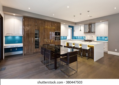 Modern kitchen and dining area in new luxury house
