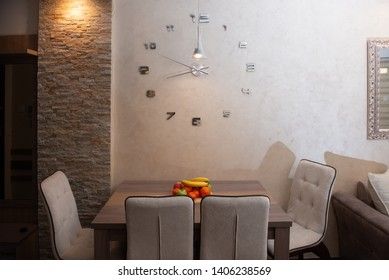 Modern kitchen for a family of four with a large clock on the wall