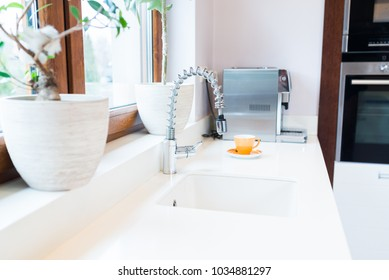 Modern kitchen faucet and sink in kitchen