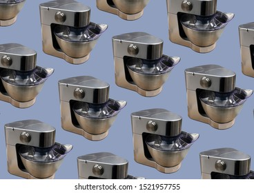 Modern kitchen food processor isolated on blue background. Kitchen universal food mixer. Multifunctional food processor. Electric Kitchen and Household Domestic Appliance. Copy space. Pattern