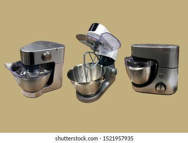 Modern kitchen food processor isolated on brown background. Kitchen universal food mixer. Multifunctional food processor. Electric Kitchen and Household Domestic Appliance. Copy space. Pattern