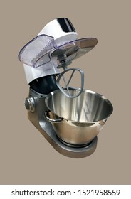 Modern kitchen food processor isolated on brown background. Kitchen universal food mixer. Multifunctional food processor. Electric Kitchen and Household Domestic Appliance. Copy space