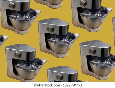 Modern kitchen food processor isolated on yellow background. Kitchen universal food mixer. Multifunctional food processor. Electric Kitchen and Household Domestic Appliance. Copy space. Pattern