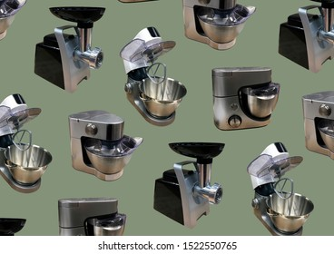 Modern kitchen food processor isolated on green background. Kitchen universal food mixer. Multifunctional food processor. Electric Kitchen and Household Domestic Appliance. Copy space. Pattern