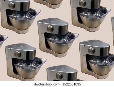 Modern kitchen food processor isolated on beige background. Kitchen universal food mixer. Multifunctional food processor. Electric Kitchen and Household Domestic Appliance. Copy space. Pattern