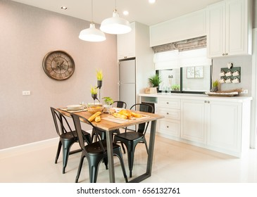 Modern Kitchen Interior Design with Fridge and dinning table
