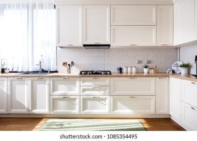 Modern kitchen interior design with white furniture and modern details