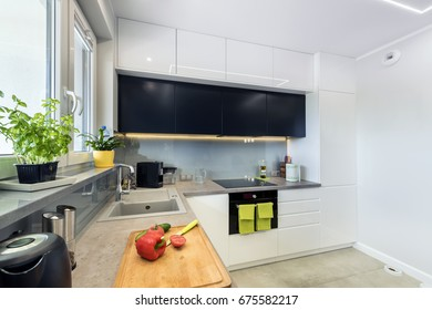 Modern kitchen interior design in white and black finishing