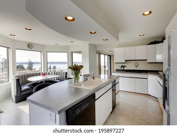 Modern kitchen interior with dining area. Room decorated with fresh tulips.