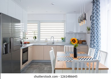 Modern kitchen interior with dining table