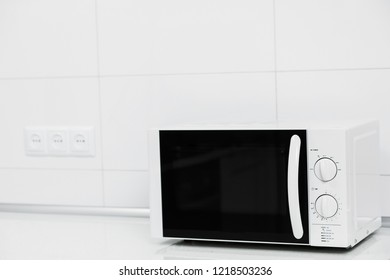 Modern kitchen interior with electric and microwave oven. Front view.