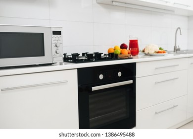 Modern kitchen interior with electric and microwave oven. New kitchen  at home with healthy food.