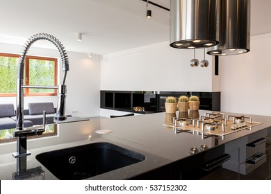 Modern kitchen interior with a high-polished countertop and sink