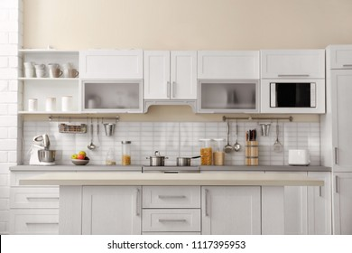 Modern kitchen interior with houseware and new furniture