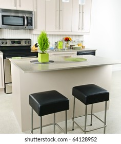 Modern kitchen interior with island and natural stone countertop