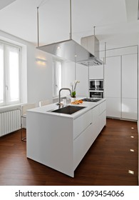 modern kitchen interior with kitchen island and wooden floor