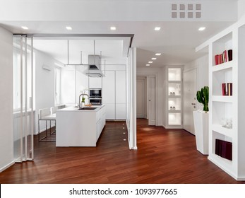 modern kitchen interior with kitchen island and wooden floor near to main door