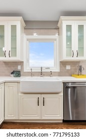 Modern kitchen interior with new stainless steel appliance and Farmhouse Sink.