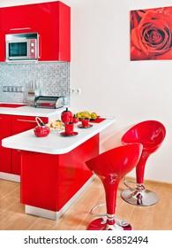 Modern kitchen interior with red decoration