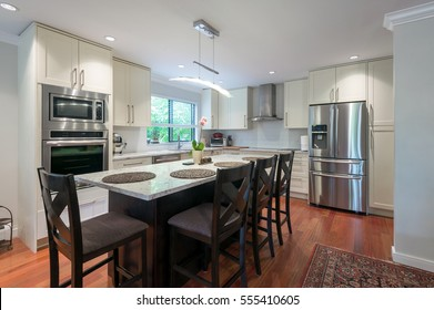Modern kitchen interior with stainless steel appliances in a luxury house.
