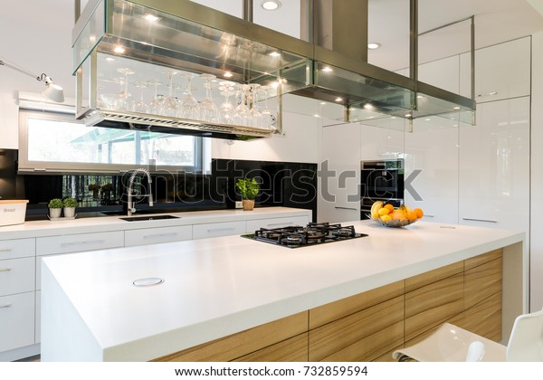 Modern kitchen island with wide table top and shelf for glasses