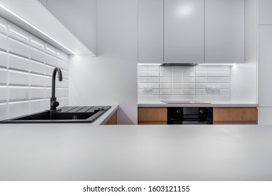 Modern kitchen iterior design in white with wooden finish