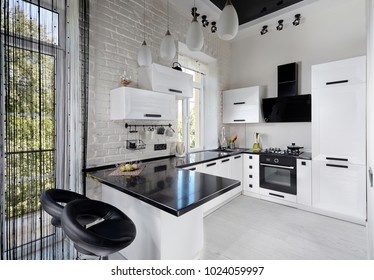 Modern Kitchen in Light and Black Tones