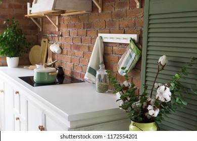 Modern kitchen in loft style, brick wall, interior details, white table.