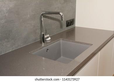Modern kitchen metal faucet and  ceramic kitchen sink.