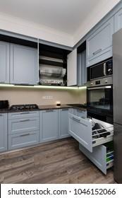 Modern kitchen, minimalistic clean design. some doors open