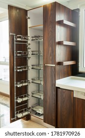 Modern kitchen, opened wooden drawers with accessories inside, solution for kitchen storage, minimalist interior design
